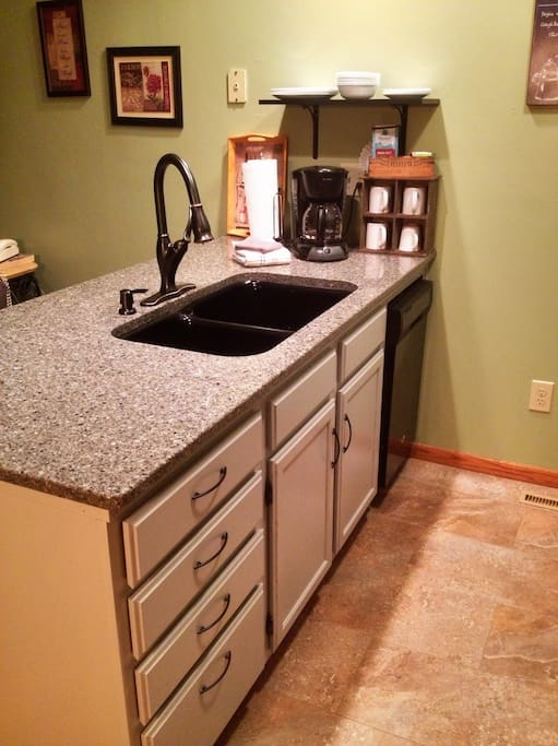 Quartz countertops and new appliances complete our kitchen renovation