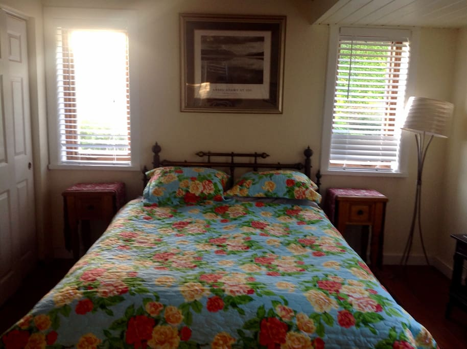 Cozy queen bed in room with private entrance