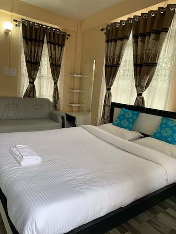 Bedroom 2 with all the amenities on the room like electric kettle, water jug, water glass.The room is with big space and attached with bathroom and with wardrobe.
