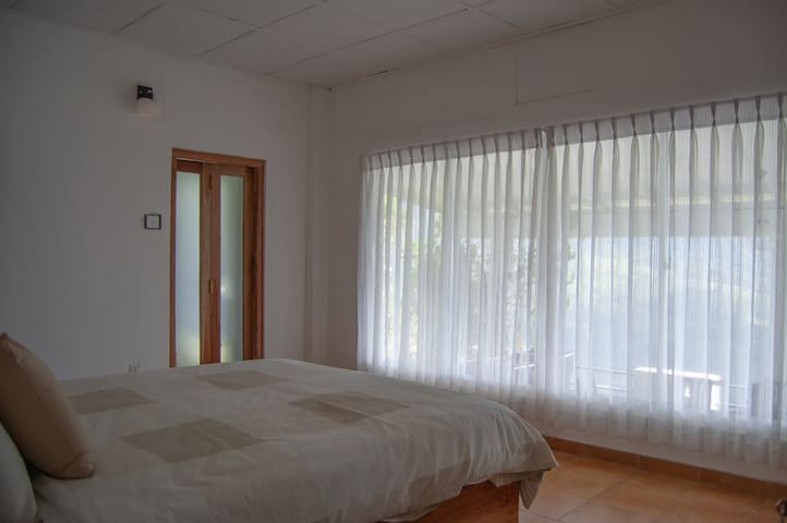 bedroom  with seven virgins hills view,has private bathroom