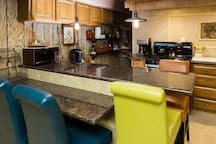Dining area seating with granite breakfast bar.