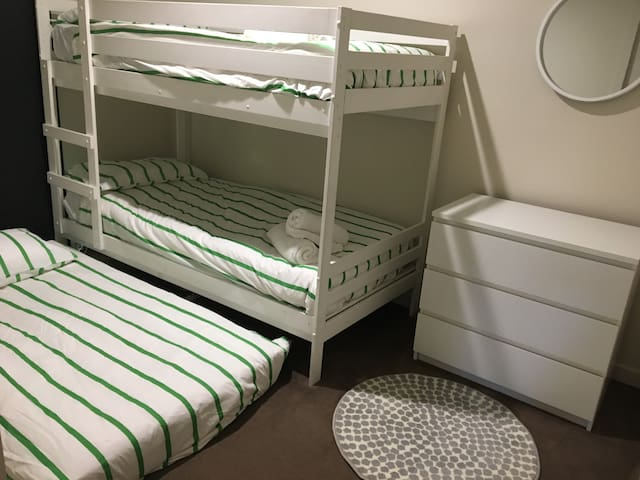 Two single bunk beds & wall heater & dresser. Stylish & comfortable