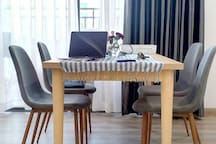 Dining table and also good for working table just next to a big balcony with view to the river and city center