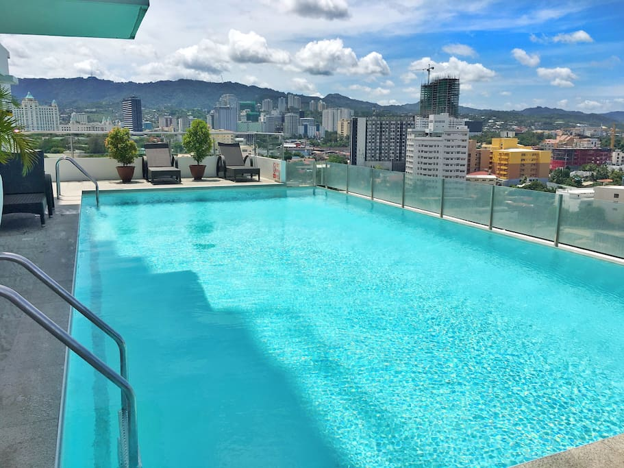 Take a dip in the pool with a relaxing view of the city.