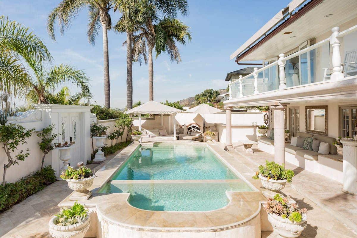 Walk to the Beach from a Palatial Retreat with a Pool