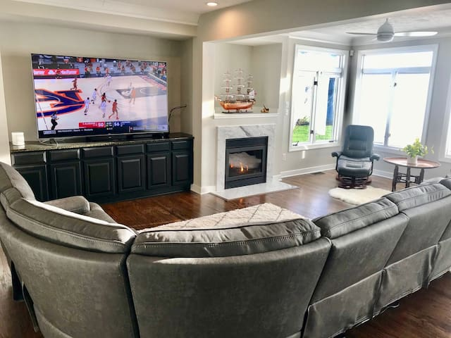 """NEW 85"""" Sony smart TV - amazing to watch your favorite sports or movies. Very large reclining sectional sofa seats 9."""