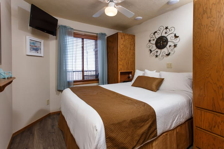 The fully enclosed bedroom has a comfortable queen size bed, with triple sheeted bedding.  The cabinets offer both drawers and hanging space.