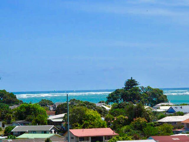 "Raglan Harbour Views ""The Beach House"""