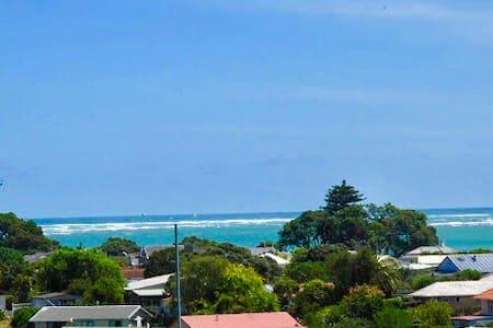 """Raglan Harbour Views """"The Beach House"""""""