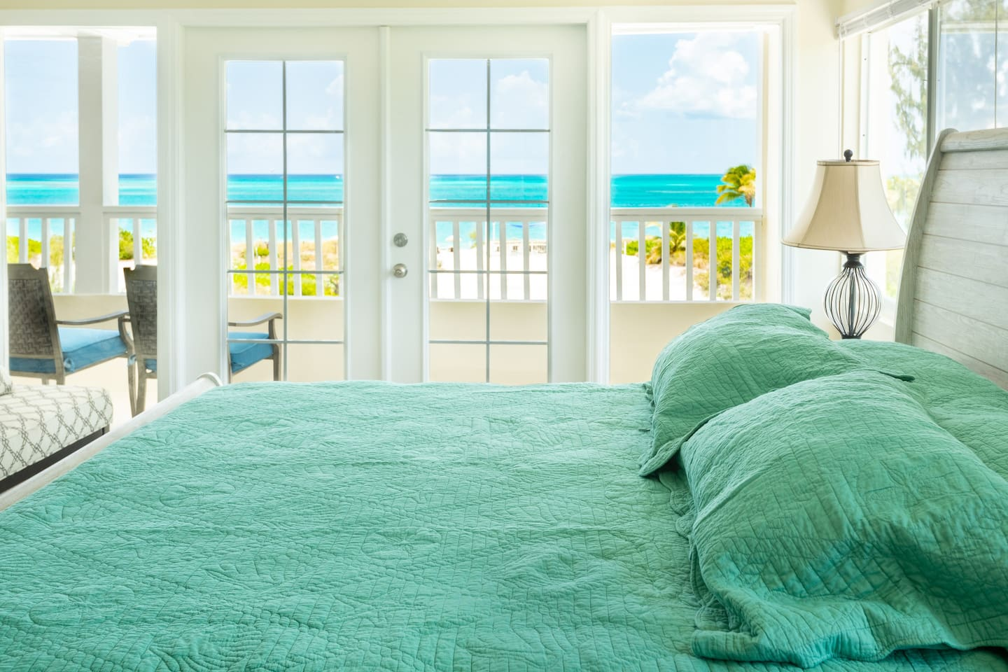 """Spacious 3rd floor """"master"""" bedroom with king bed and amazing views of Grace Bay."""