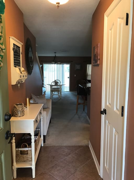 As you walk in through the front door...  bathroom is immediately to the left as you walk in. Kitchen to the right.