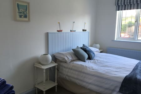Sunny double room in village home