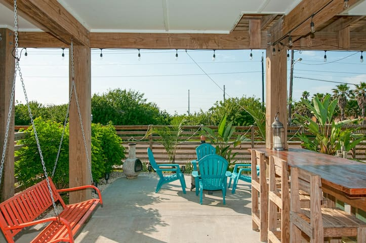 Enjoy the refreshing Gulf breeze from the comfort of an outdoor patio.