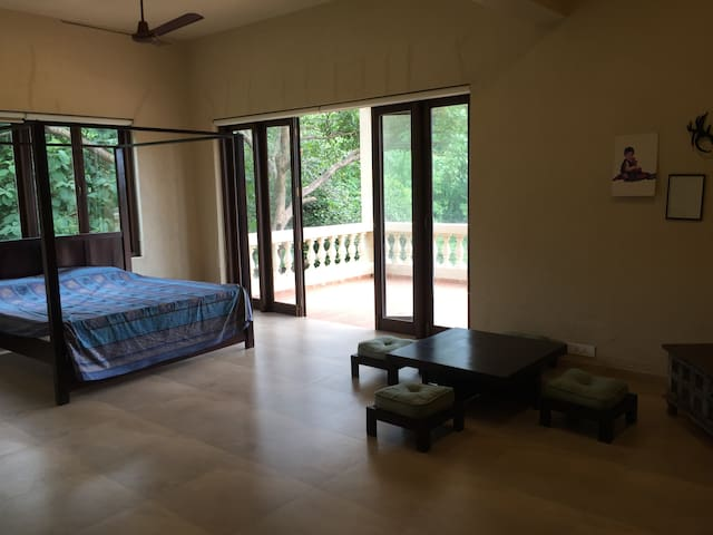 Large air-conditioned bedroom with balcony and all western toilet