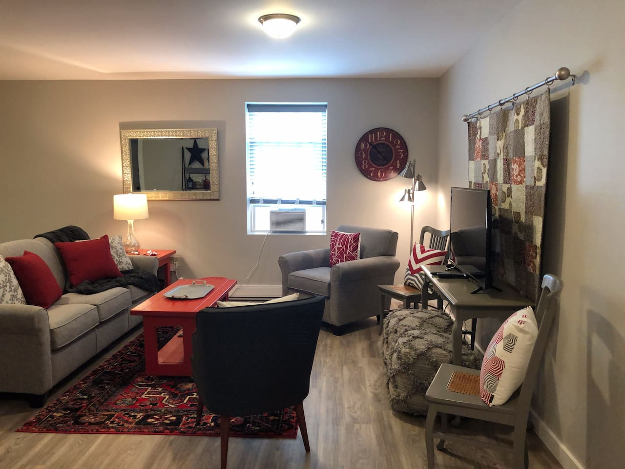 Comfortable seating in the living room, open to the kitchen and dining area.