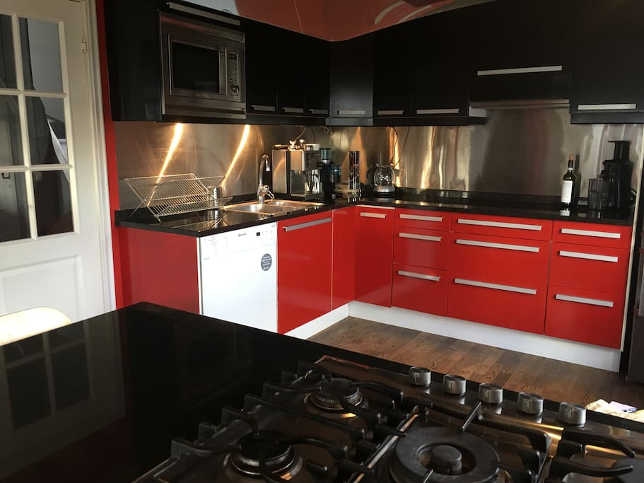 Fully equipped kitchen with gas hob