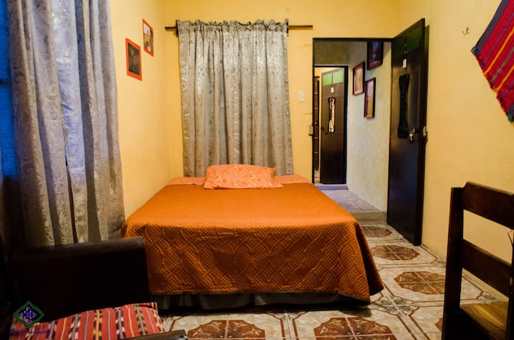 room with comfortable bed and variety of amenities