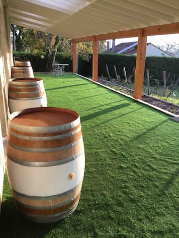 Shared terrace for relaxing and no need for shoes.  Barrels can be moved to provide privacy.