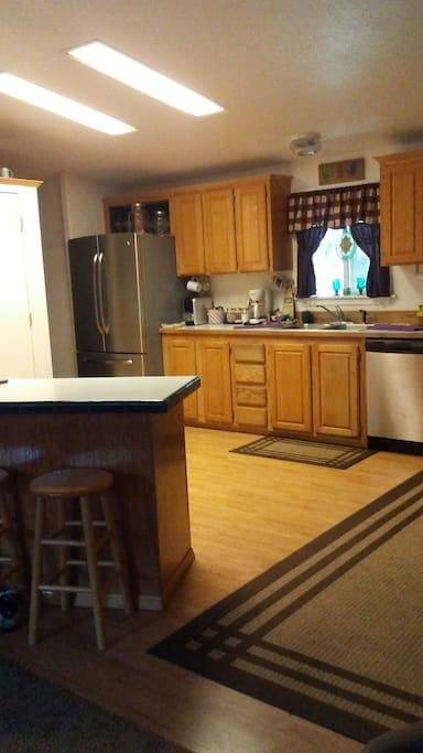 shared kitchen w/ bar stools