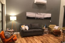 """The main living area also provides a pullout """"American Leather"""" queen sized sleeper sofa in case you want to upgrade to additional guests or prefer not to climb stairs to the """"Birdnest"""" loft."""