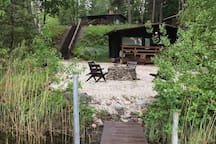 The Sauna building and the outdoor fire place!