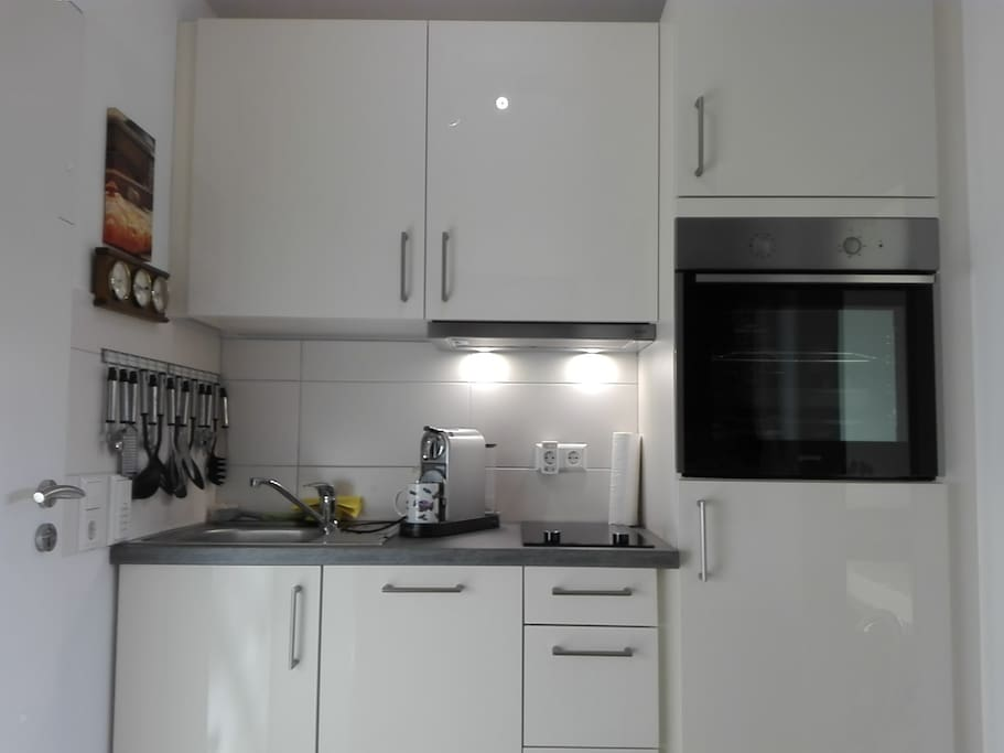 new kitchen with oven, dishwasher, microwave etc.