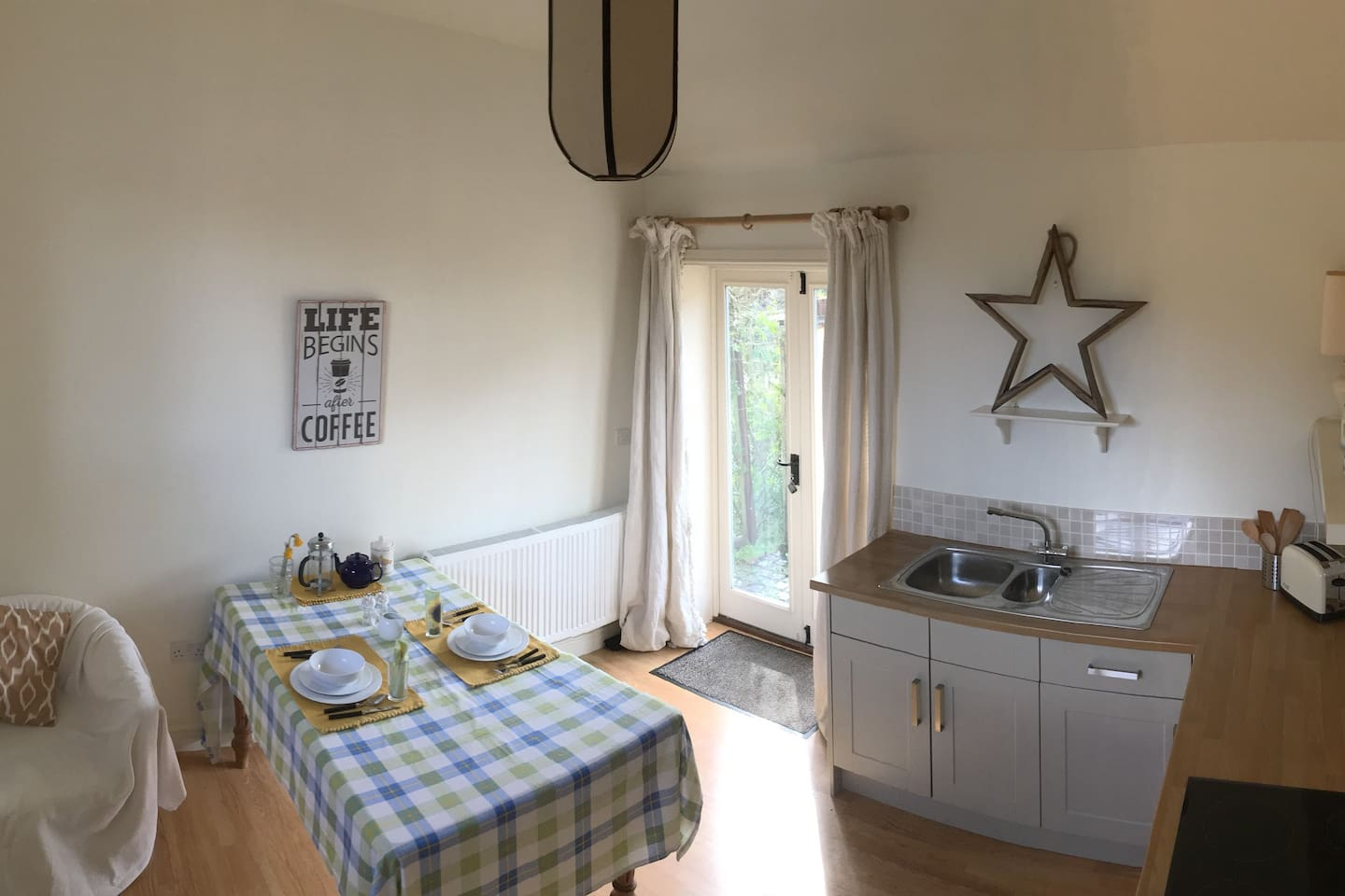 Spacious kitchen with 2 armchairs, well equipped and dining table