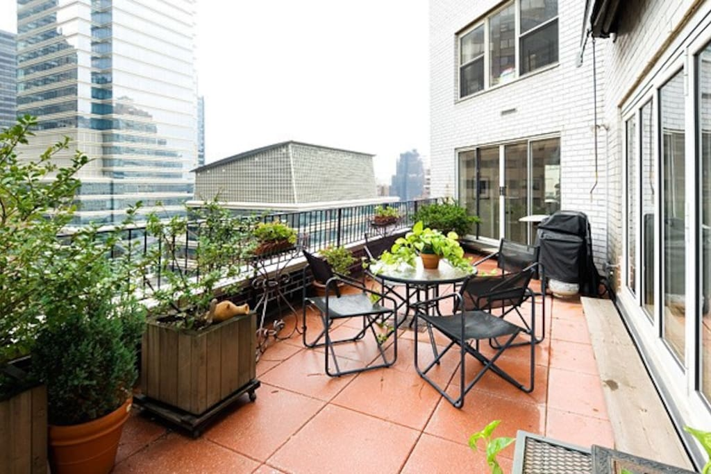 terrace to look out from and enjoy the new york city skyline view