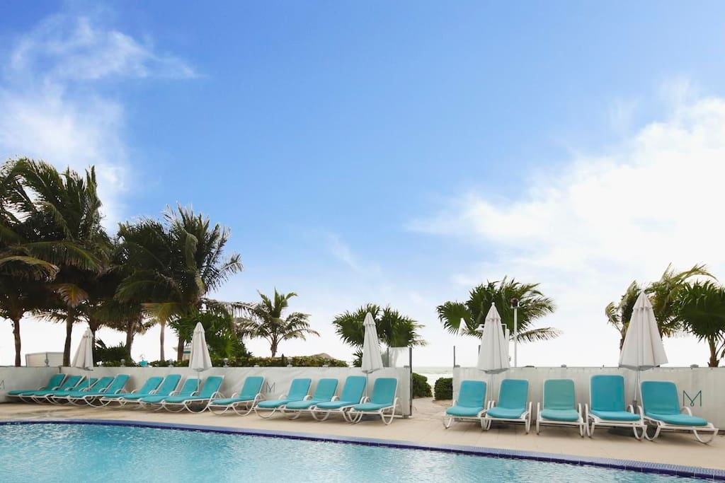 Outdoor swimming pool and lounge chairs