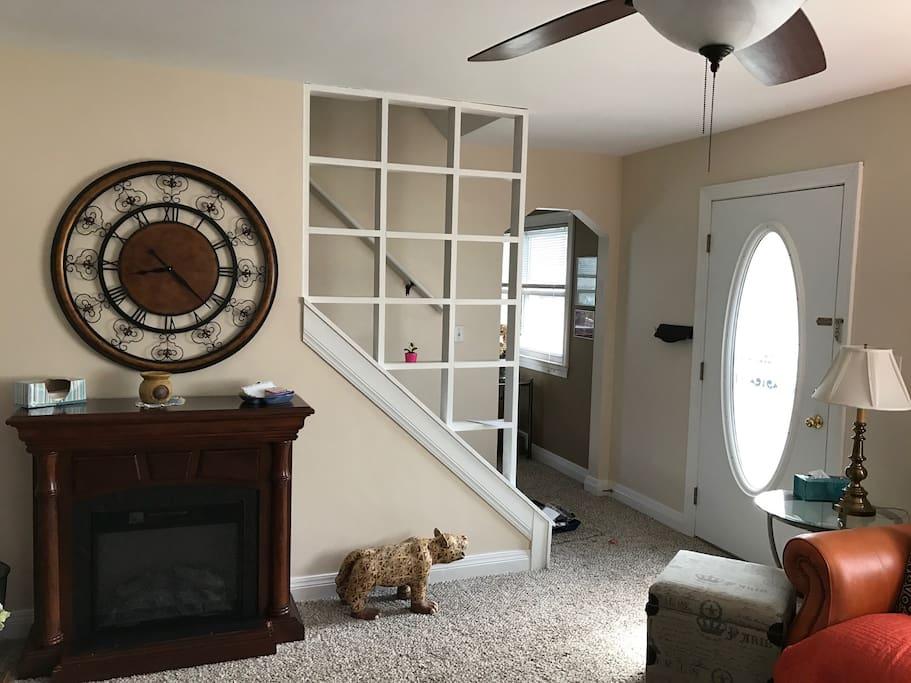 Front door, stairway, entry to dining room