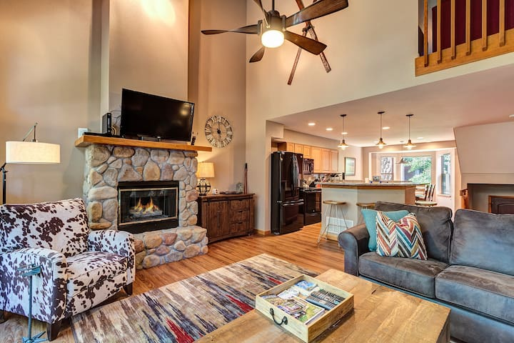 Living room is bright and airy with vaulted ceiling and cozy fireplace.  Chest is stocked with games, puzzles and cards.
