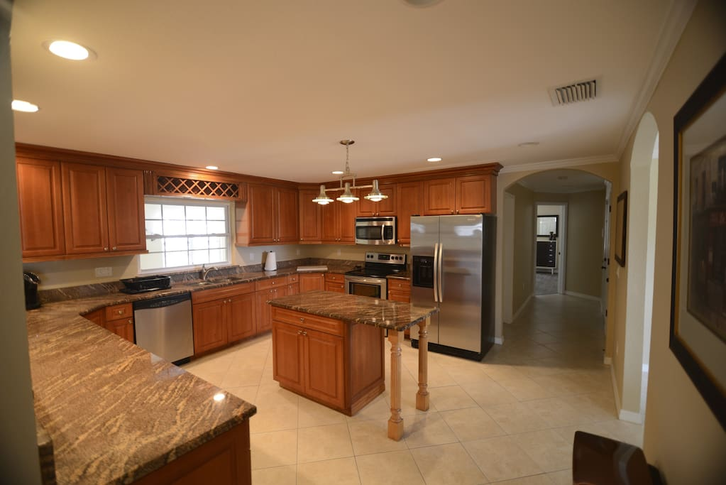 Stainless appliances & granite countertops highlight the beautiful kitchen.