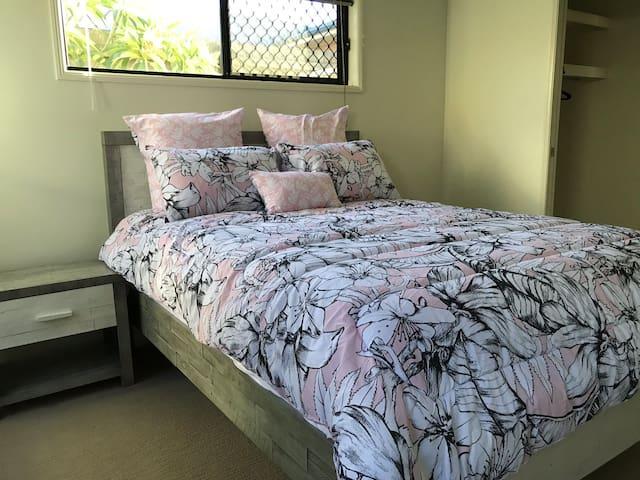 Comfy Queen bed with walk in robe and en-suite.