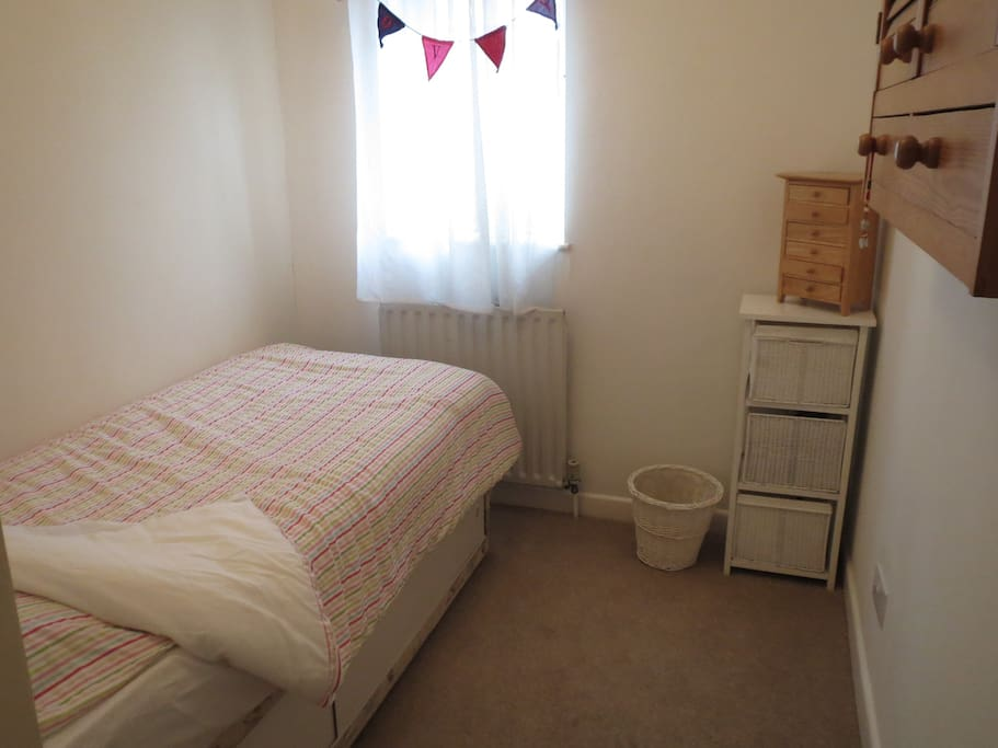 Smaller bedroom, has a single bed (small bed)