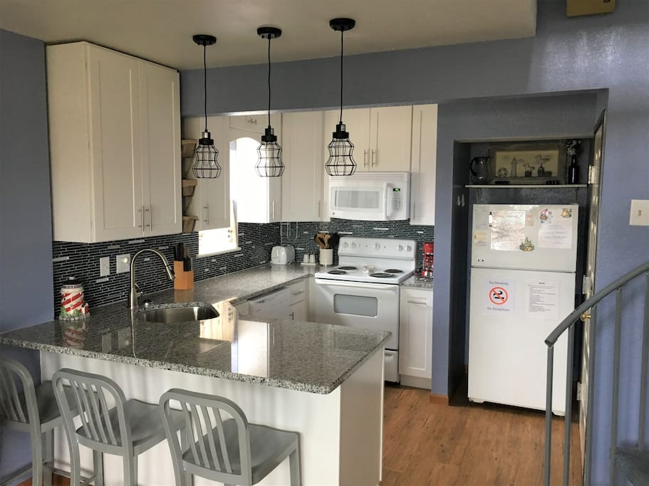 NEWLY REMODELED!  Fully stocked open view kitchen, with full sized appliances and eating area!