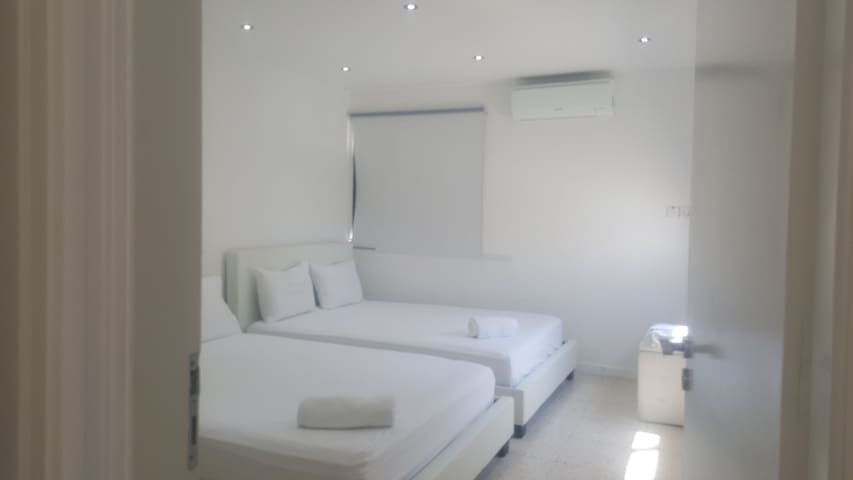 one double bedroom with two double beds.