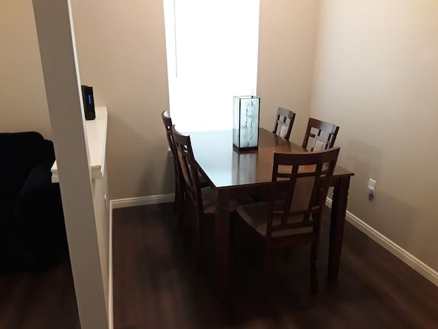 Dinning table that seats up to six people. Sixth chair can be pulled in from the second bedroom.