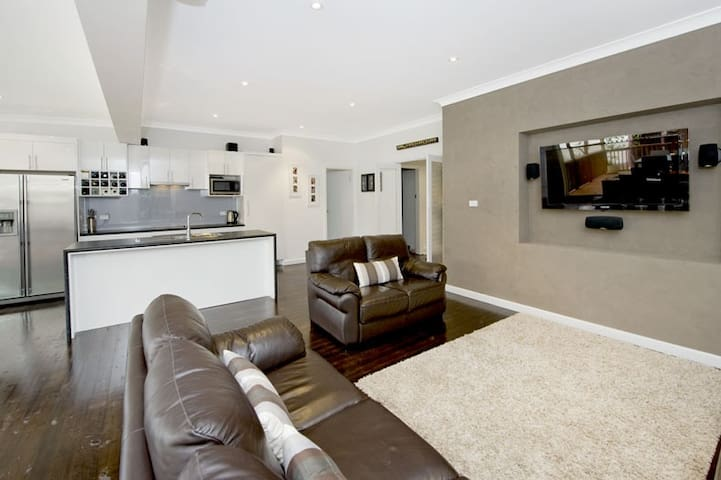 Open plan kitchen and lounge room with Foxtel and Netflix