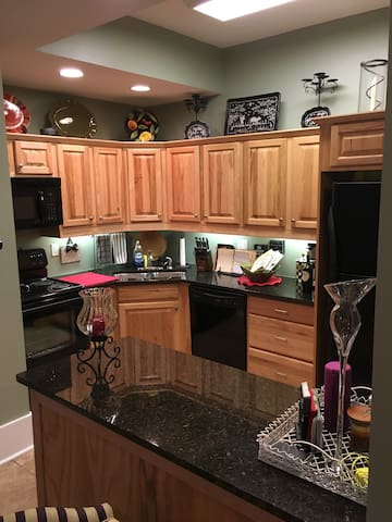 The kitchen is fully stocked and includes the typical appliances, instant pot, coffee maker, blender, etc.