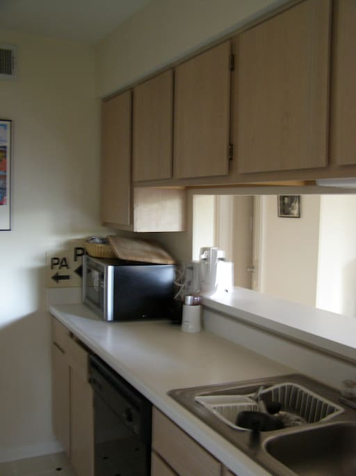 full kitchen with gas stove & large refrigerator