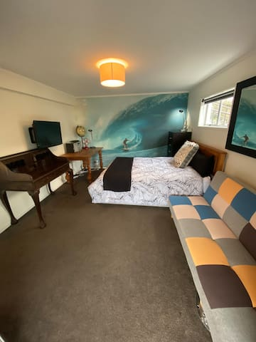 Surf Mural Room Xtra includes front door entrance & downstairs toilet for your convenience.
