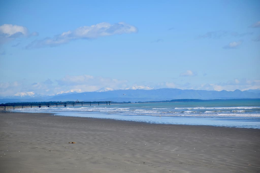 Beautiful Kaikoura Mountain range overseeing the architecturally unique Brighton Pier, iconic in Christchurch the Pier is 4kms beach walk from our gate beach entrance.
