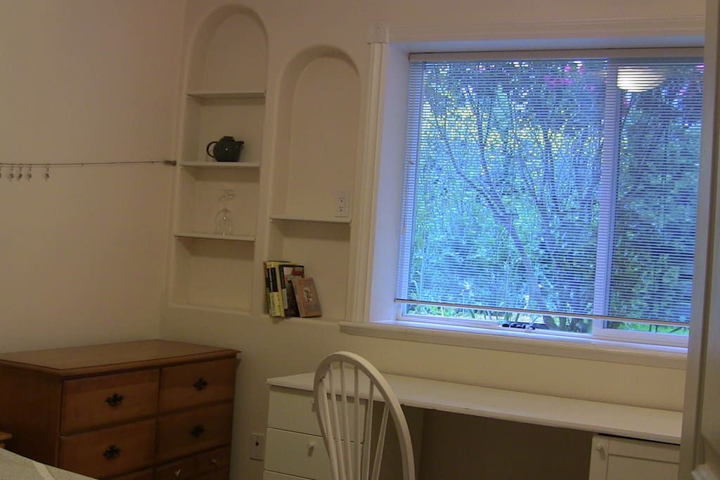 Large desk in front of large south-facing window