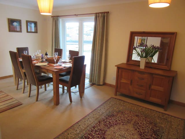 Dining area with French windows to loch view