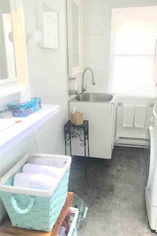 Bathroom & Laundry: deep stainless steel sink for easy rinsing out of bathing suits.