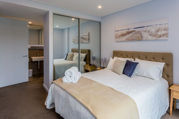 Master bedroom has an en-suite and builtin wardrobe.  Side tables with lamps and alarm clock. From this room you have  access to a 2nd balcony.