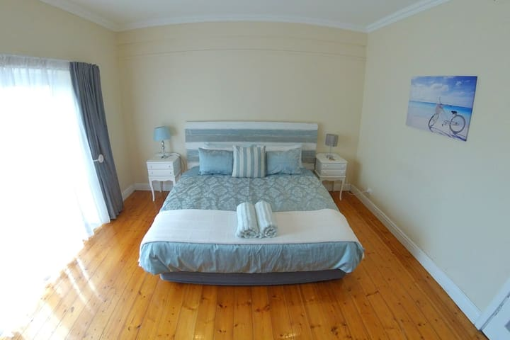 Bedroom 2: Opening onto pool deck with King size bed, 50 inch TV with XBox One and Netflix. Solid wood floors and relaxed beach feel.