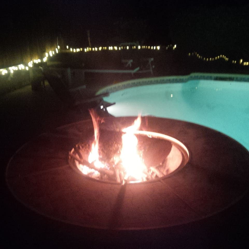 Fire Pit overlooking the diving pool in the backyard paradise.
