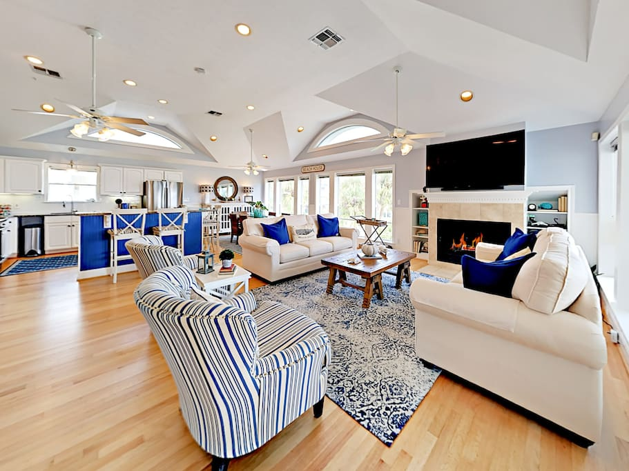 Relax on 2 sofas and 2 cute accent chairs while the flickering fireplace warms the space.