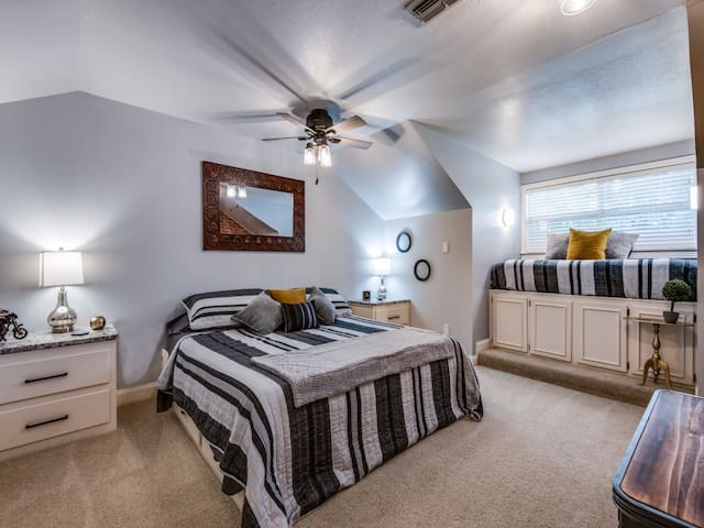 Upstairs Guest Bedroom with king and twin beds and seating area.